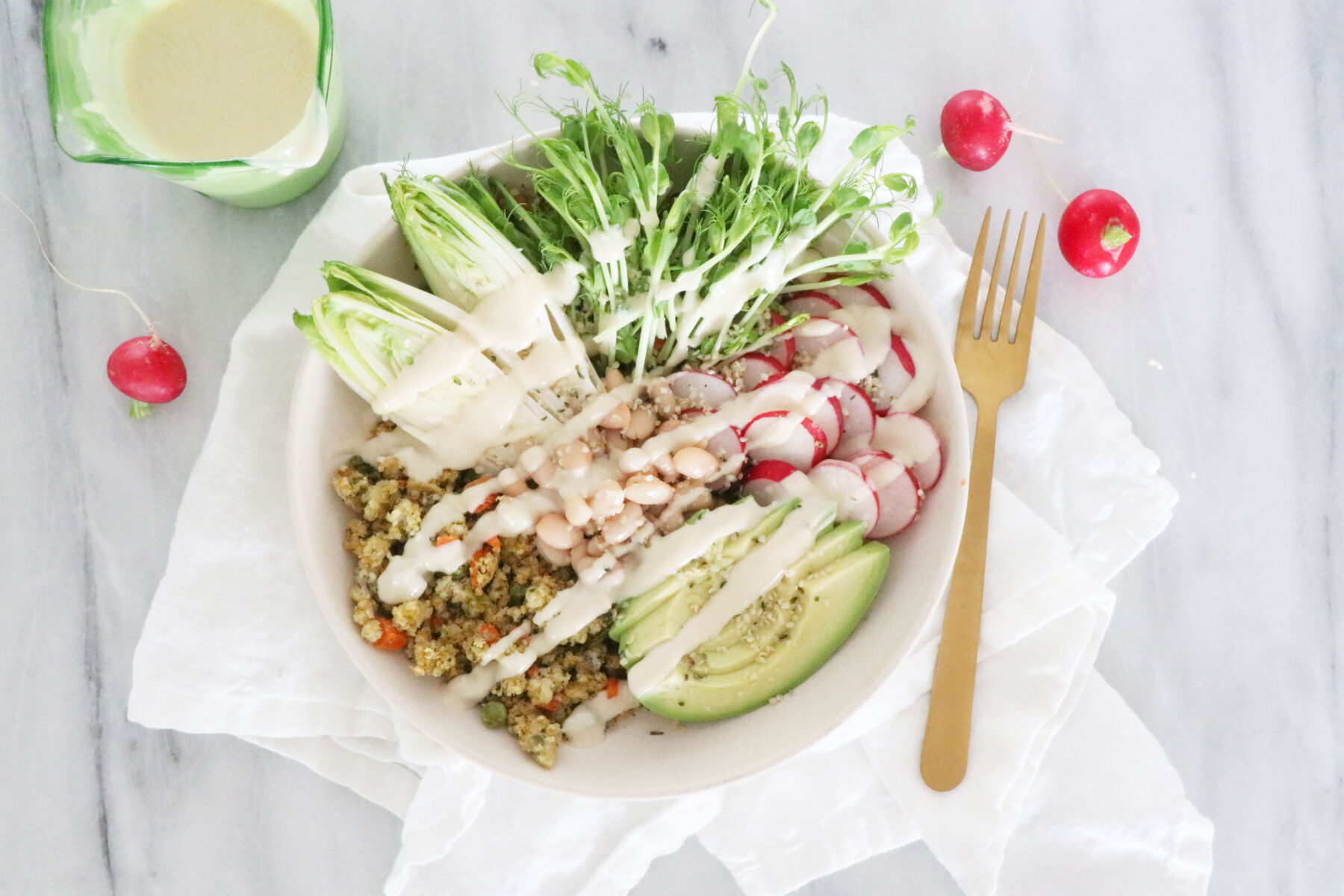 Bowl of Millet Medley, Avocado, Greens, Veggies and Lemon Tahini Dressing