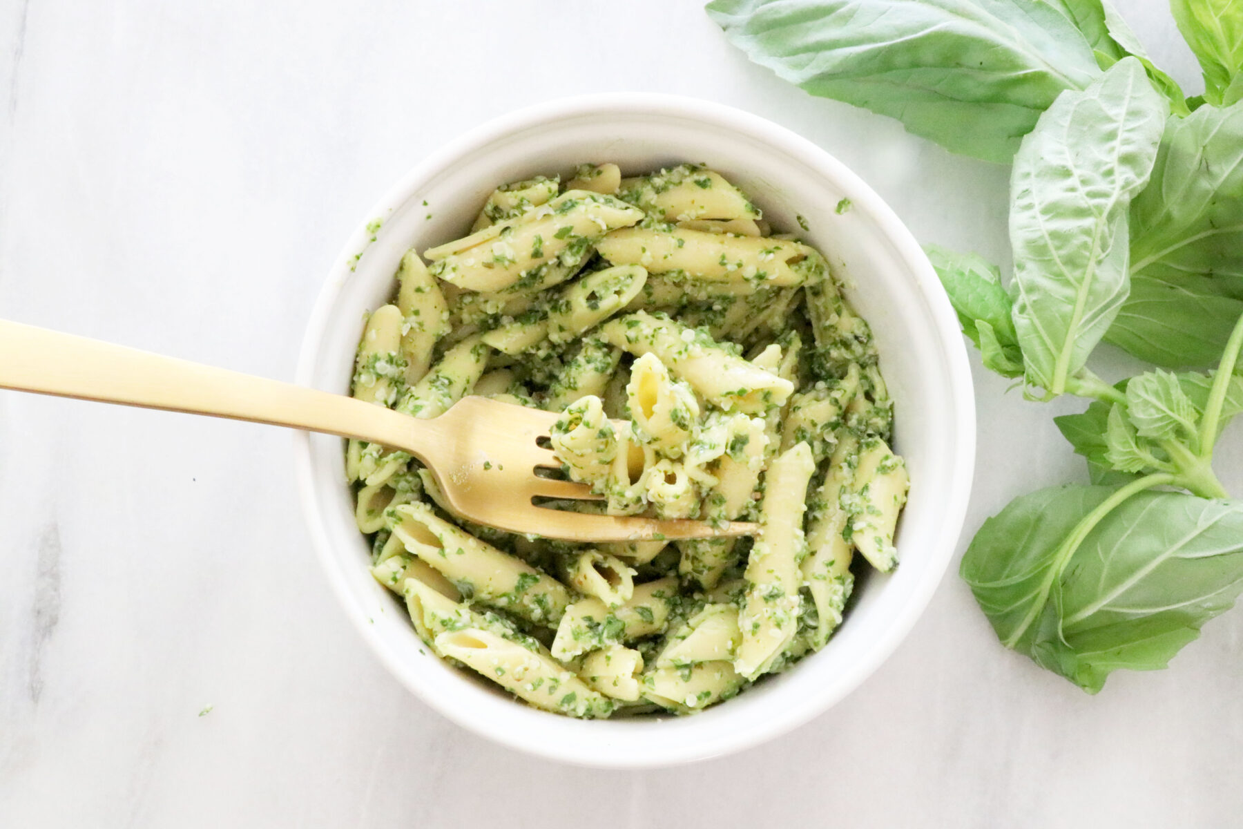 Bowl of Pasta Noodles Mixed with Dairy-Free Pesto with Fresh Basil