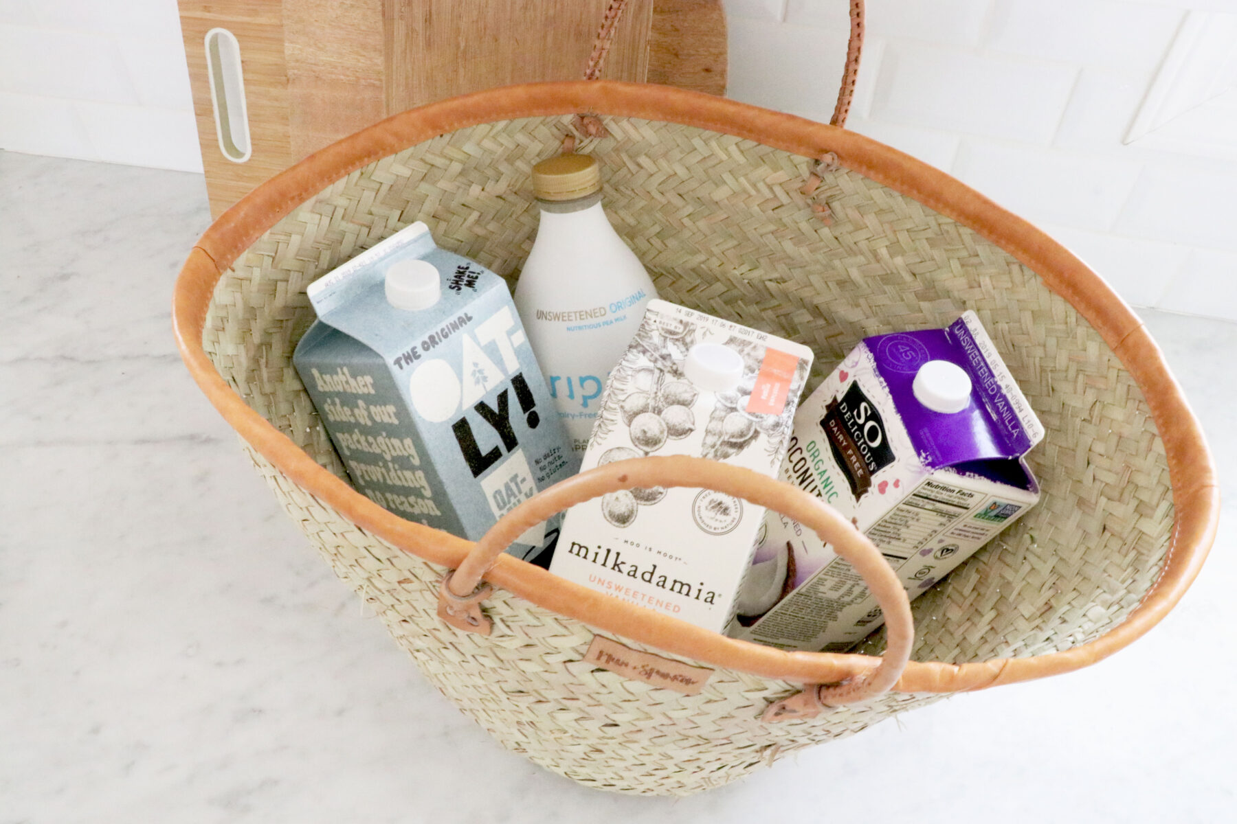 Large basket filled with different non-dairy milks.