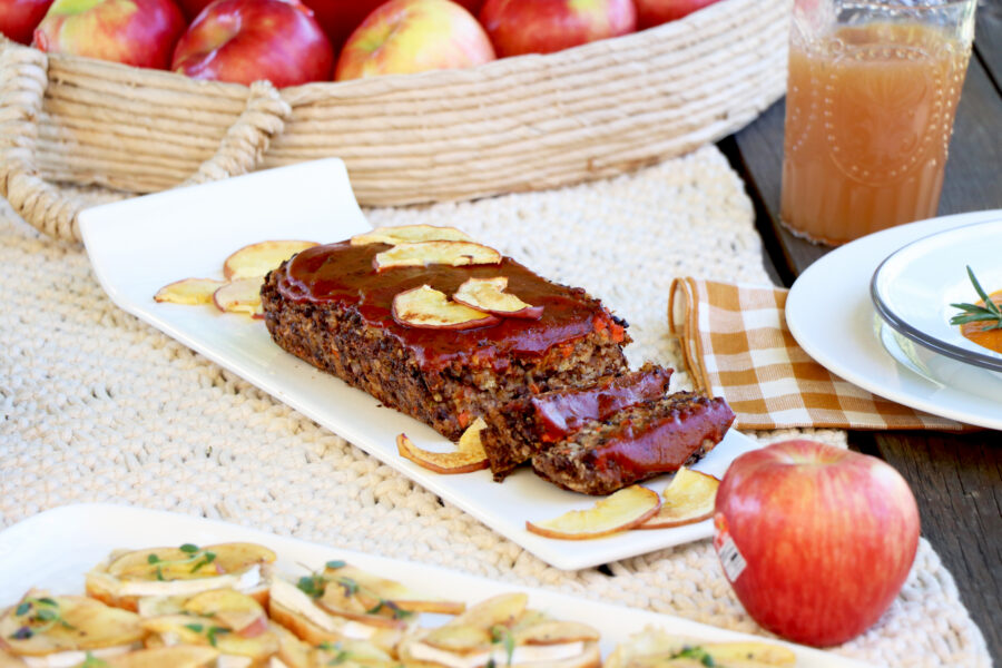 Apple Lentil Loaf on white serving dish with slices of apples as garnish