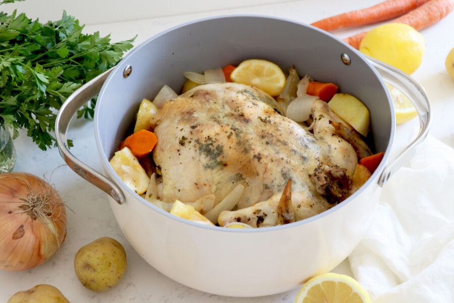 Large pot with lemon upside down chicken and veggies.
