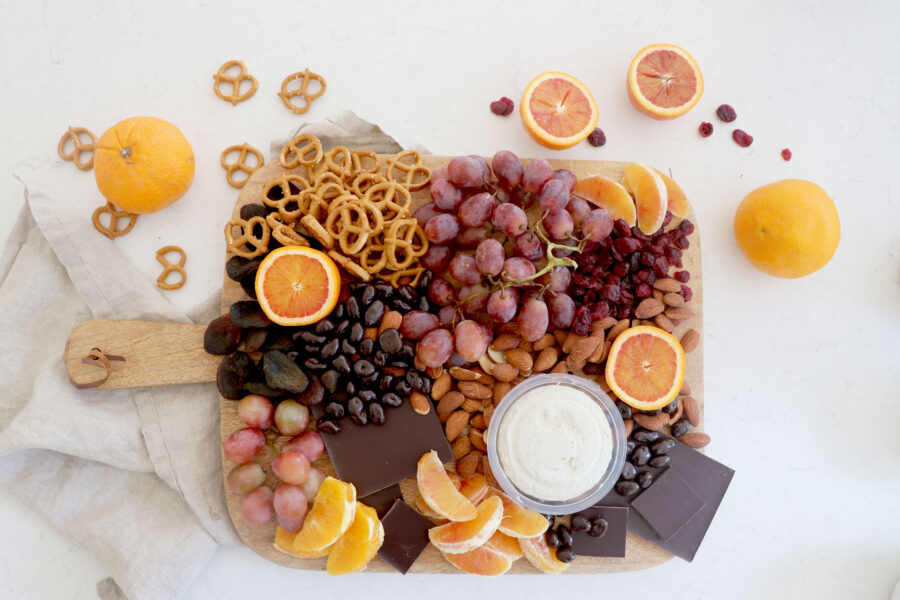 Holiday snack board with citrus, chocolate and other fruit.