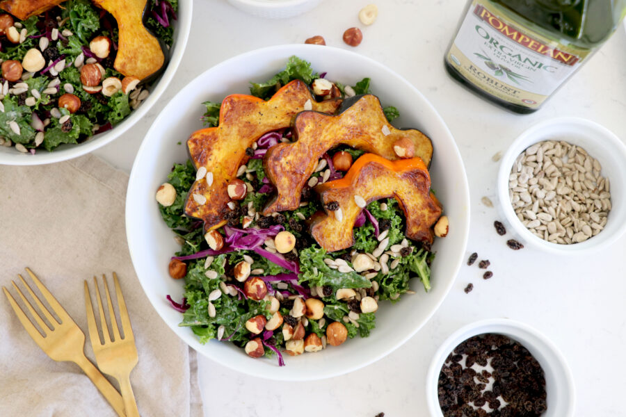 Acorn squash salad with kale and olive oil tahini dressing.