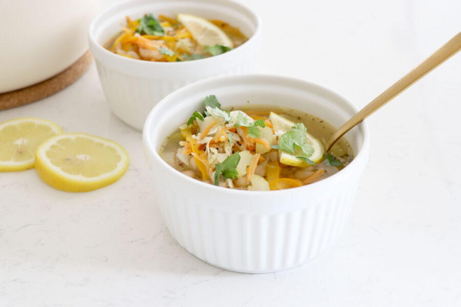 Bowls of soup with spoon in front bowl.