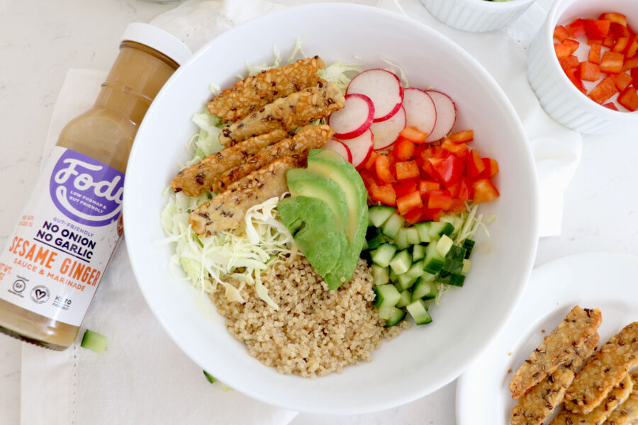 Fody dressing with white bowl filled with nourish bowl ingredients.