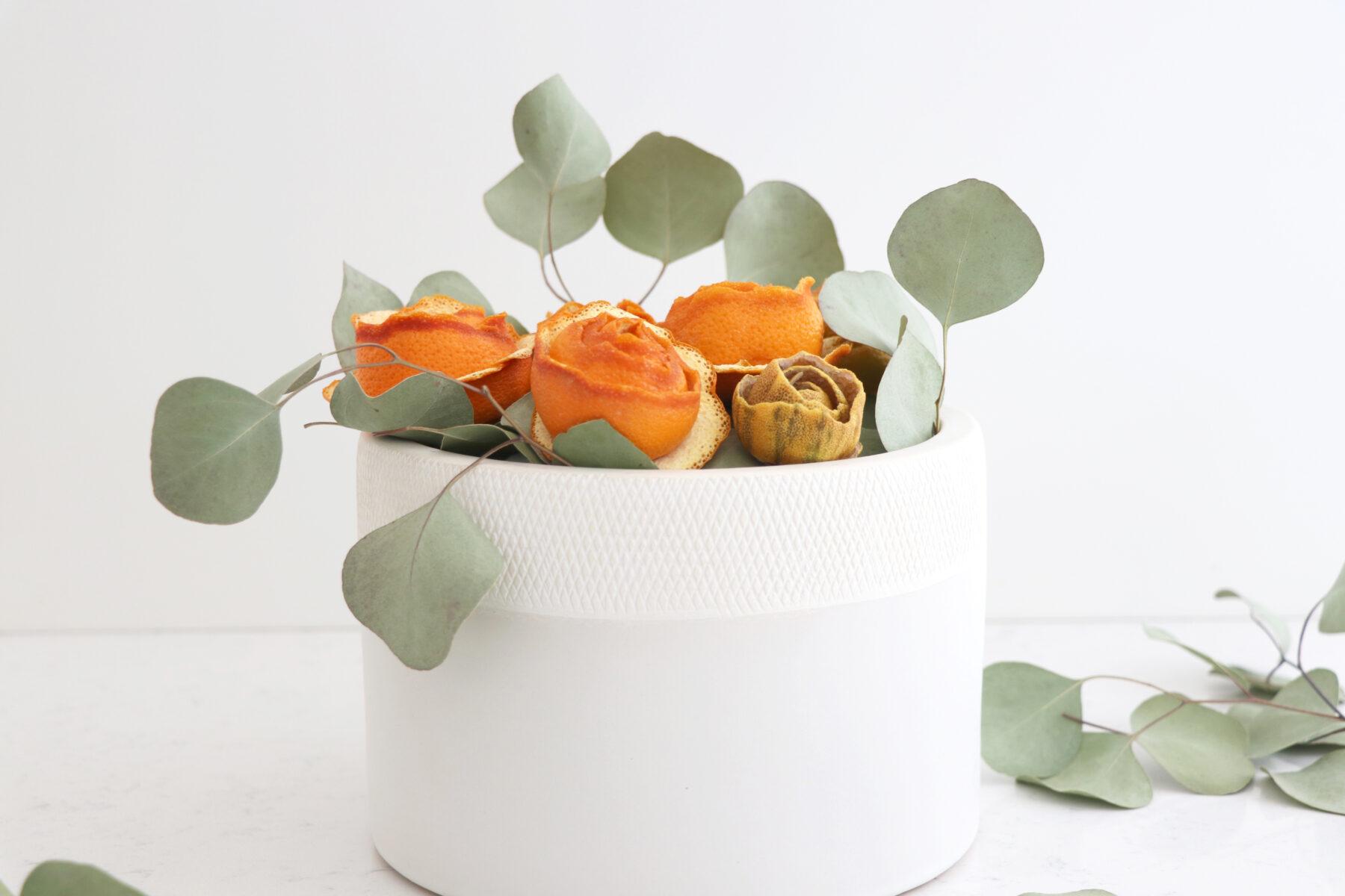 White flower pot with dried citrus rose bouquet