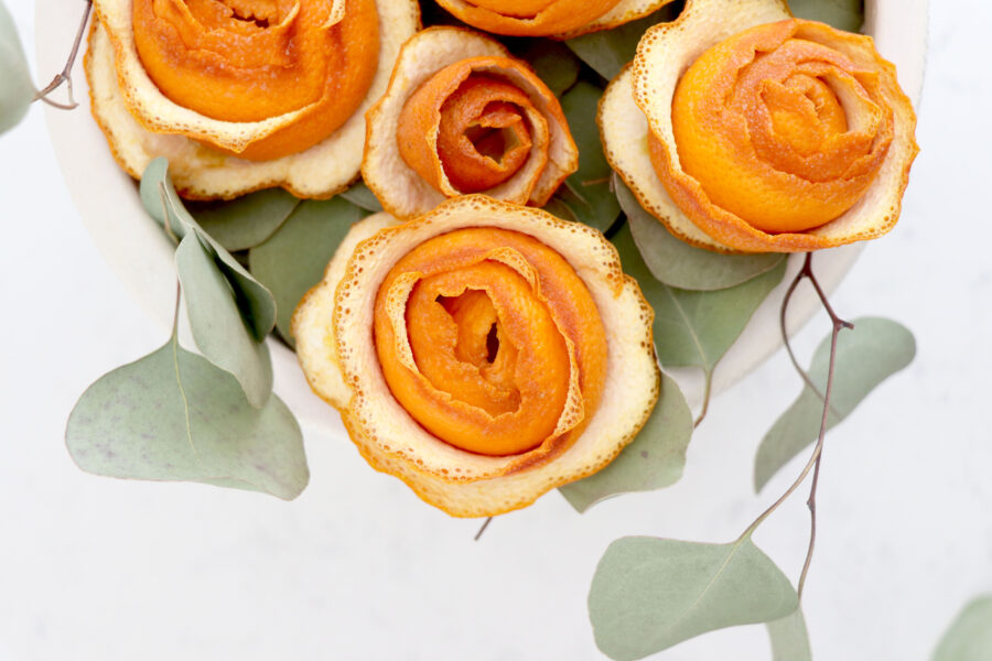 Dried citrus bouquet with greenery.