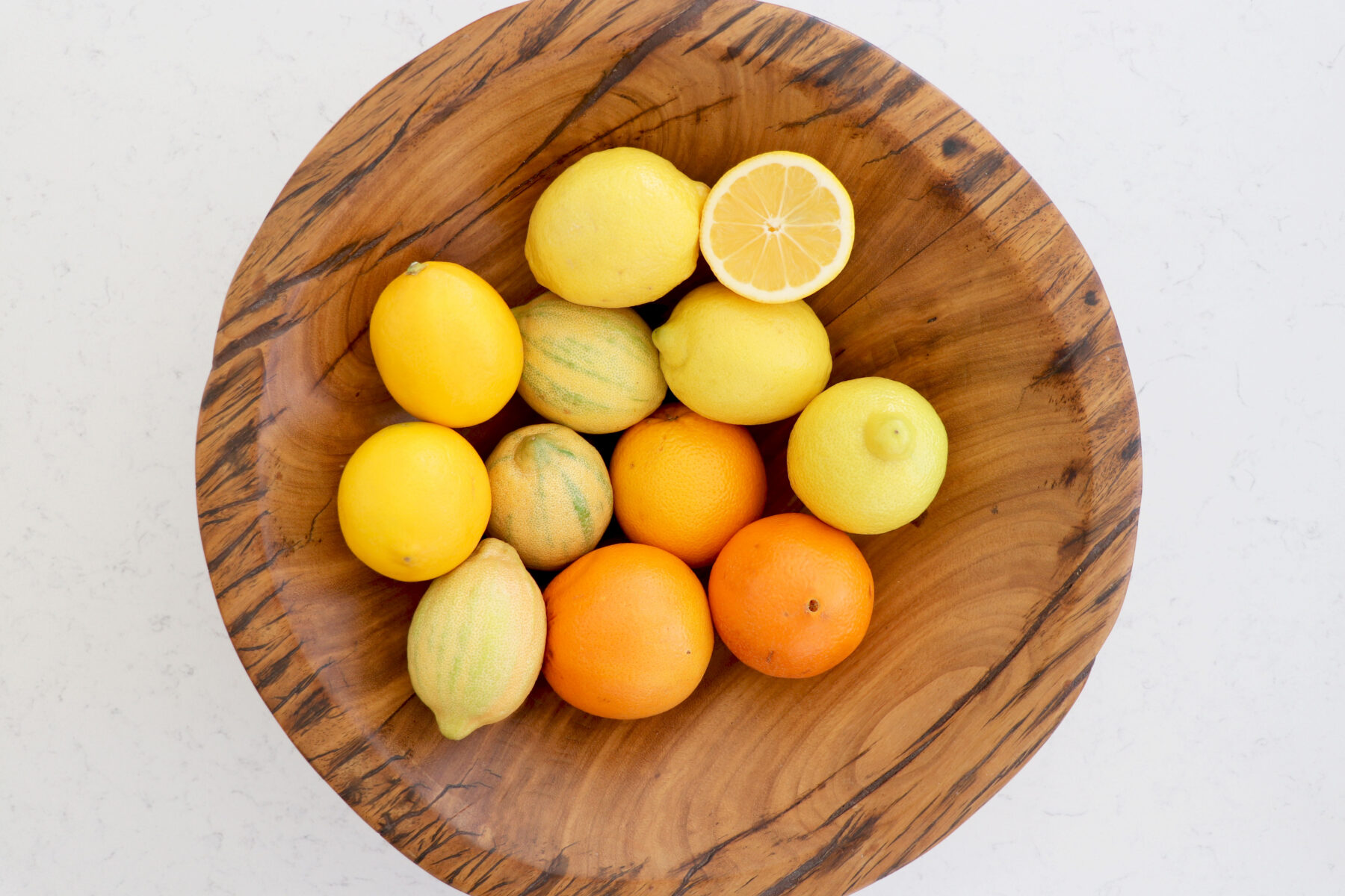 Wooden bowl with citrus.