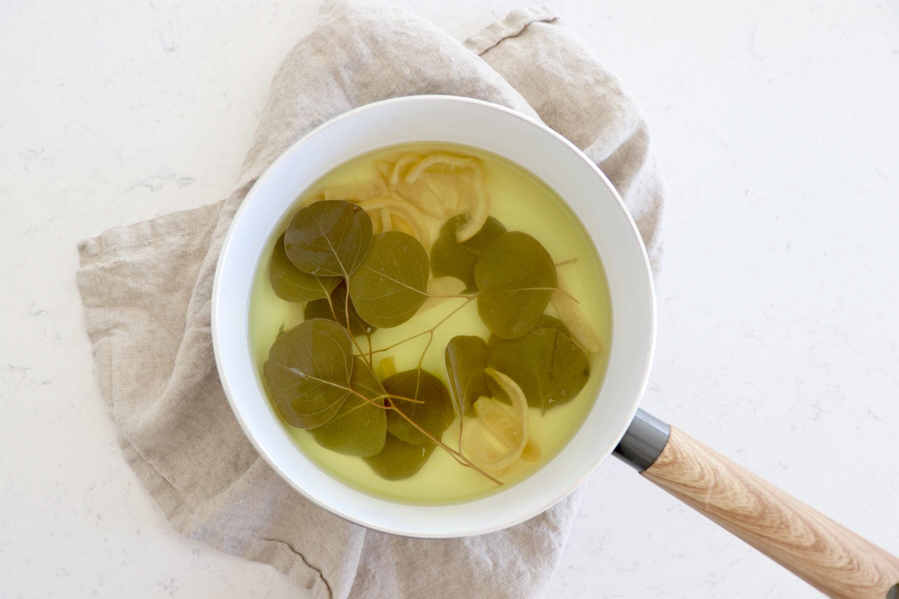 Saucepan with lemon and eucalyptus leaves.
