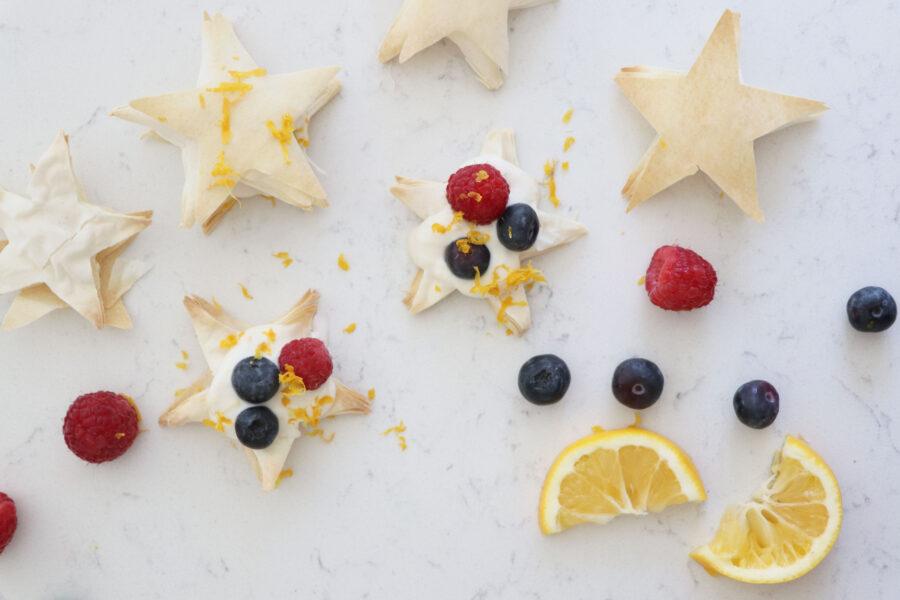 Puff pastry stars with greek yogurt, berries and lemon zest.