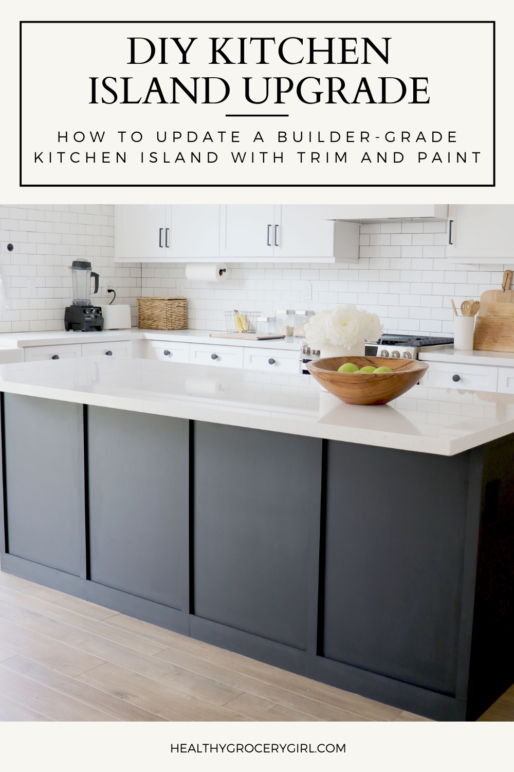 Kitchen Island with board and batten trim painted black and white quartz countertop